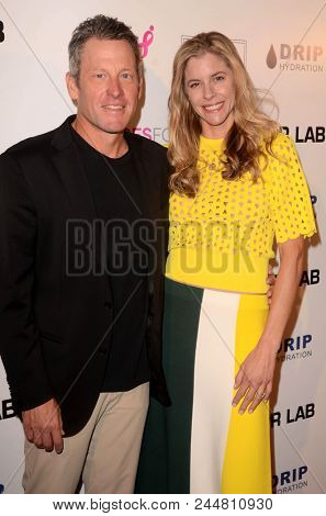 LOS ANGELES - JUN 7:  Lance Armstrong, Anna Hansen at the 4th Annual Babes for Boobs Live Bachelor Auction at the El Rey Theater on June 7, 2018 in Los Angeles, CA
