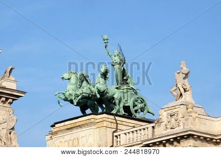 BUDAPEST, HUNGARY - OCTOBER 14: Statues on roof of Museum of Ethnography in Budapest, Hungary. The building located at Kossuth Square, across from the Hungarian Parliament, on October 14, 2017.