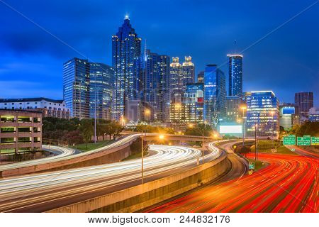 Atlanta, Georgia, USA downtown skyline over the highways at dusk.
