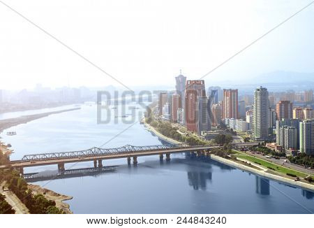 Aerial view of new residential complex and Daedong River (Taedong River), Pyongyang - capital city of North Korea (DPRK). View from Yanggakdo island