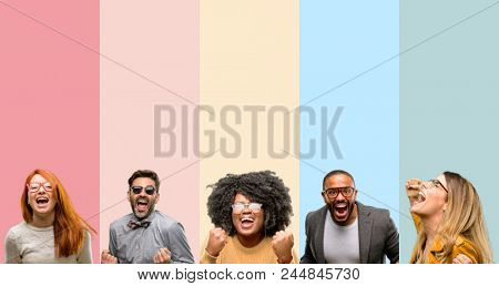 Cool group of people, woman and man happy and excited celebrating victory expressing big success, power, energy and positive emotions. Celebrates new job joyful