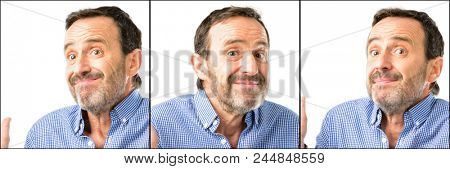 Middle age handsome man closeup doubt expression, confuse and wonder concept, uncertain future shrugging shoulders