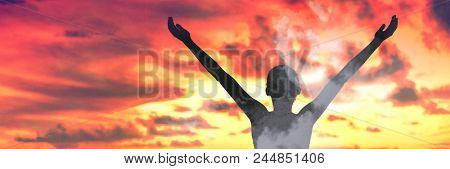 Free wellness woman in sky clouds sunset panorama. Freedom person with open arms in happiness, double exposure meditating. Meditation zen concept.