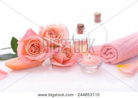 Spa sitting with orange rose ,  towel,bottle oil, candle,