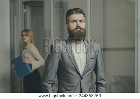 Bearded Man In Formal Suit In Office. Man With Beard And Mustache On Serious Face. Confident Busines