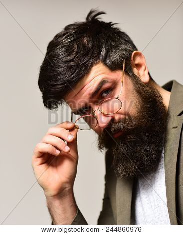 Fashion Accessory And Business Style. Bearded Man With Stylish Hair. Hipster With Long Beard And Mus