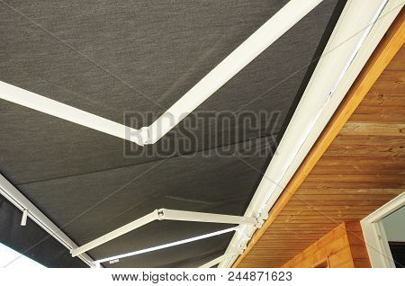 Protection Against Sun And Heat. Sun Protection Patio Awning . Outdoor Patio Sun Shade Awning.  Wood