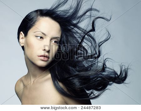 Photo of young beautiful woman with magnificent hair poster
