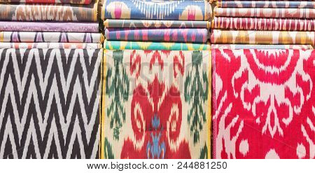 Traditional Uzbek Asian Silk Fabric Roll. Colorful Traditional Uzbek Xonatlas Hon Atlas Textile Fabr