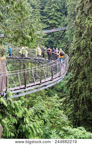 Vancouver - Jun 29, 2011: Visitors Explore The Vancouver Capilano Cliff Walk Through Rainforest Vege