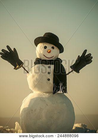 Joyful Snowman. Snowman Gentleman In Winter Black Hat, Scarf And Gloves. Xmas Or Christmas Party. Ha