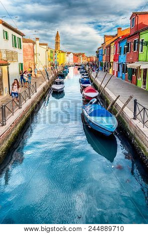 Venice, Italy - April 30: Colourful Houses Along The Canal On The Island Of Burano, Venice, Italy, A