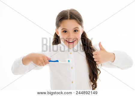 Girl Cute Long Curly Hair Holds Toothbrush White Background. Child Girl Holds Toothbrush With Paste