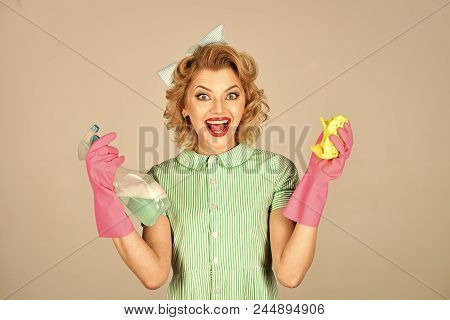 Cleanup, Cleaning Services. Pinup Woman Hold Soup Bottle, Duster. Retro Woman Cleaner On Grey Backgr