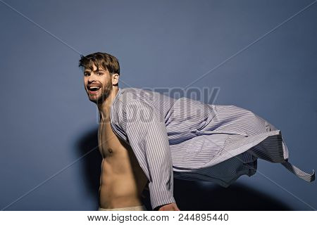 Fashion, Style Concept. Happy Bachelor With Sexy Torso In Flying Bathrobe. Man Smile In Dressing Gow