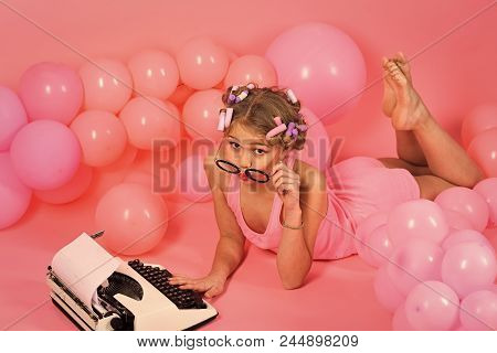 Decoration With Inflatable Balls. Writer Typing On Old Typewriter. Writer Girl Typing On Typewriter,