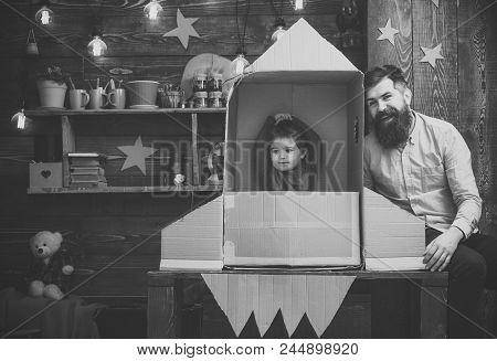 Cosmonautics. Rocket Launch Concept. Kid Happy Sit In Cardboard Hand Made Rocket. Boy Play With Dad,