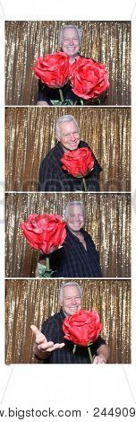 Photo Booth strips. A man poses and smiles as he has his picture taken in a photo booth and printed on strips. room for text.