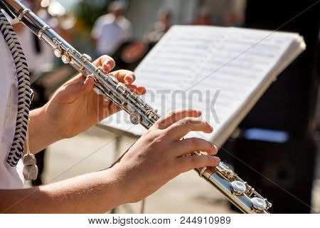 Girl Plays On Flute. Flute In  Hands Of  Girl During The Concert. Professional Musician Playing On