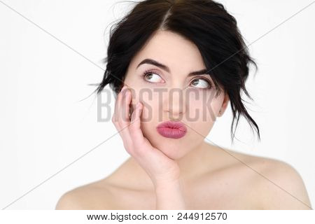Emotion Face. Bored Disinterested Indifferent Woman. Young Beautiful Brunette Girl Portrait On White