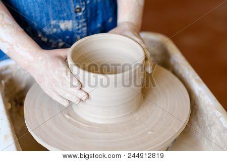 Pottery Handicraft Skills. Traditional Art Of Creating Ceramics. Little Crafty Child Potter Modeling
