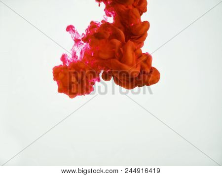 Image Of Red Ink Swirl Isolated On White Background. Abstract Background Of Red Ink Dropped Into Wat