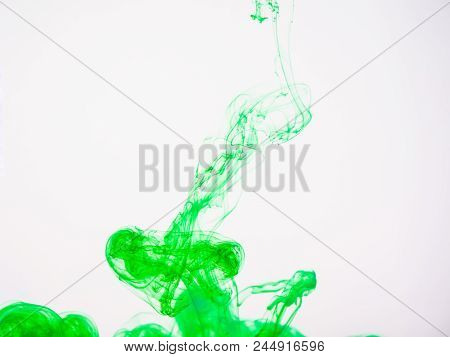 Green Acrylic Paint Swirling Under Water. Image Of Green Coloured Acrylic Swirl In Liquid. Movement