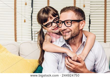 Portrait Of Little Girl With Daddy Smiling And Look At Camera At Home.love Of Family And Father Day