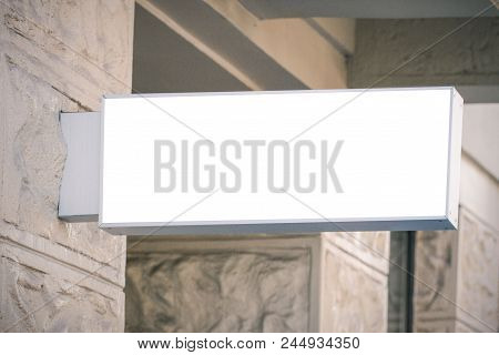 Mock Up. Blank White Signage On The Wall Of Classical Architecture Building.