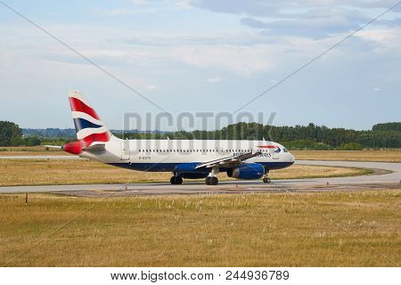 BUDAPEST, HUNGARY - MAY 13, 2018: British Airways Airbus A320 takiing to the runway at Budapest Liszt Ferenc International Airport. British Airways if the flag carrier airline of the United Kingdom.