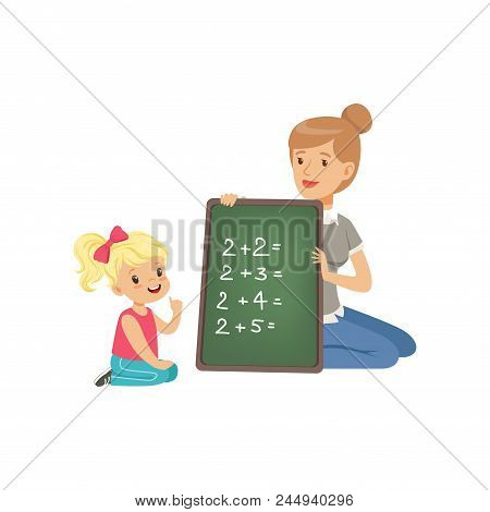 Cute Little Girl Sitting On The Floor And Writing Mathematical Examples, Teacher Holding Small Black