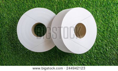 Toilet Paper - Toilet Paper Or Toilet Rolls With An Artificial Grass Texture Background. Selective F