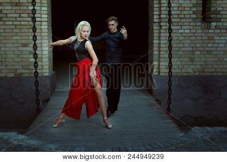 Professional Dancers Dance Tango. Young Guy And Girl On A Date Dance A Passionate Dance.