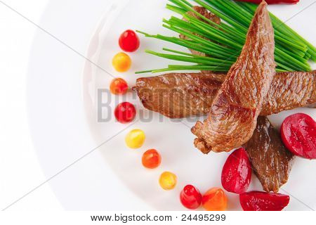 fresh roasted beef meat chunks on white plate