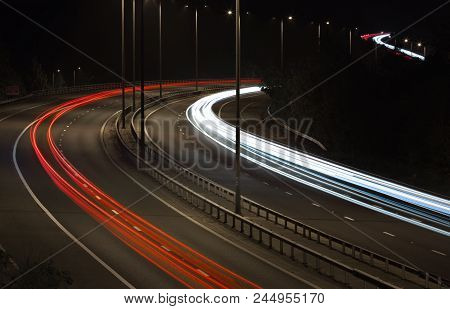 Traffic On Motorway At Night Light Trails