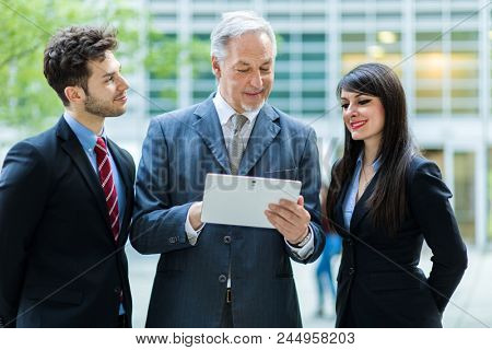 Business people using a tablet outdoor