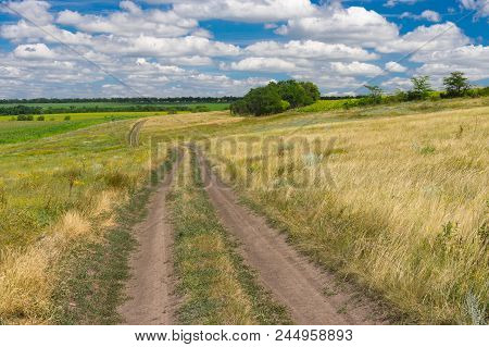 Earth Road Through Summer Meadow Near Dnipro City In Central Ukraine