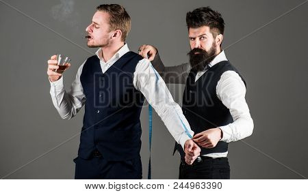 Tailor Measure Client For Sewing Custom Suit. Client, Businessman With Arrogant Face Smoke Cigar Whi