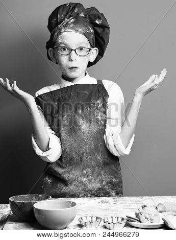 Stained Cute Cook Chef Boy. Young Boy Cute Cook Chef In Uniform And Hat On Stained Surprised Face Fl