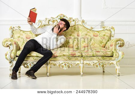 Humorous Literature Concept. Guy Reading Old Book With Enjoyment. Macho On Laughing Face Reading Boo