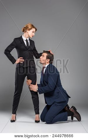 Female Boss Dominating Over Scared Businessman, Isolated On Grey, Feminism Concept