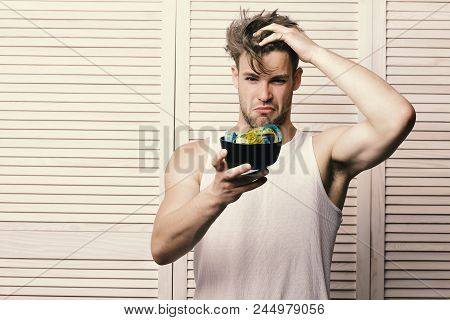 Weight Management And Sportive Diet Concept. Guy With Thoughtful Face Expression On Beige Jalousie B