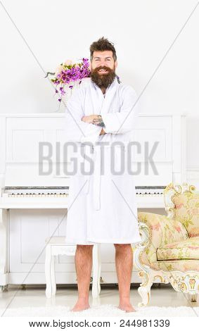 Man With Beard Enjoys Morning While Stand Near Piano And Old Fashioned Armchair. Man Cheerful, On Sm