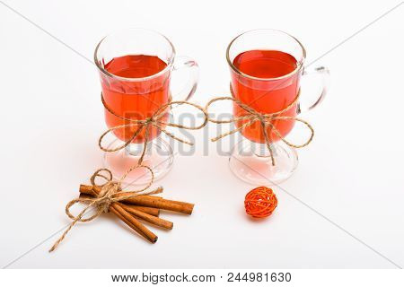 Hot Drinks Concept. Mulled Wine Or Hot Beverage In Glasses With Decoration And Cinnamon Sticks. Glas