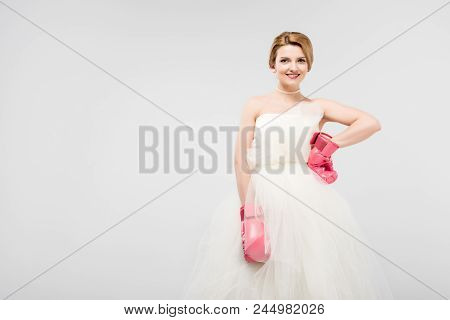 Beautiful Bride Posing In Wedding Dress And Boxing Gloves, Isolated On Grey, Feminism Concept