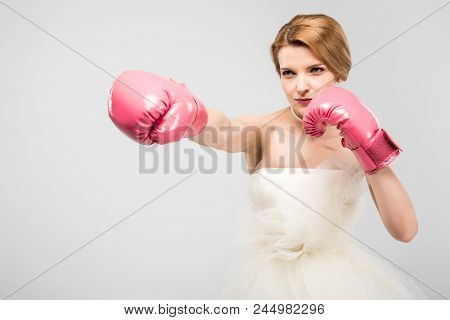 Strong Bride In Wedding Dress And Boxing Gloves, Isolated On Grey, Feminism Concept