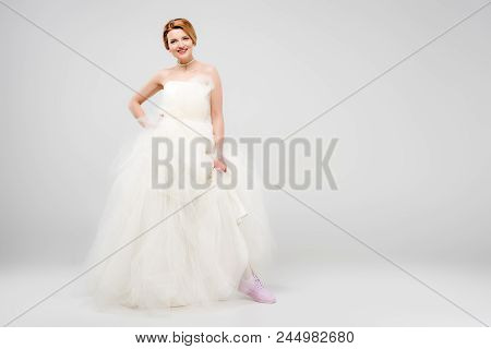 Smiling Bride In White Wedding Dress And Pink Sneakers, Isolated On Grey, Feminism Concept