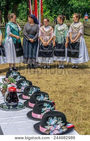 Timisoara, Romania - June 10, 2018: German Women Ethnics From Banat, In Traditional Costumes, Wait /