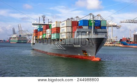 Rotterdam, The Netherlands - Sep 3, 2016: Container Ship Leaving A Shipping Container Terminal In Th
