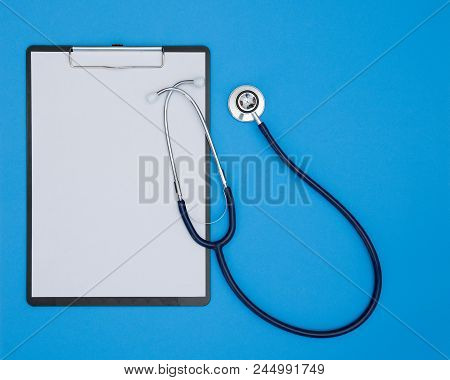 Stethoscope And Clipboard Isolated On Blue Background, Medical Inspection Concept.